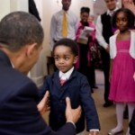 President Barack Obama greets a young visitor in the Oval Office, February 5, 2010. (Official White House Photo by Pete Souza).