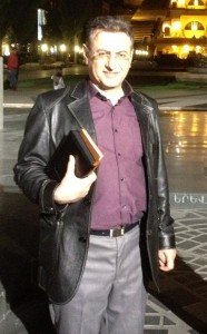 Pastor Robert Asserian, pictured here with Bible, has been released from prison but concerns remain over conditions.