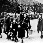 Jewish people arrive at the concentration camp and ghetto in Terezin. Their last belongings would soon be taken by the Nazis.